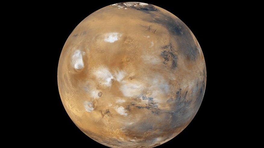 Water-ice clouds, polar ice, polar regions, and geological features can be seen in this full-disk image of Mars.
