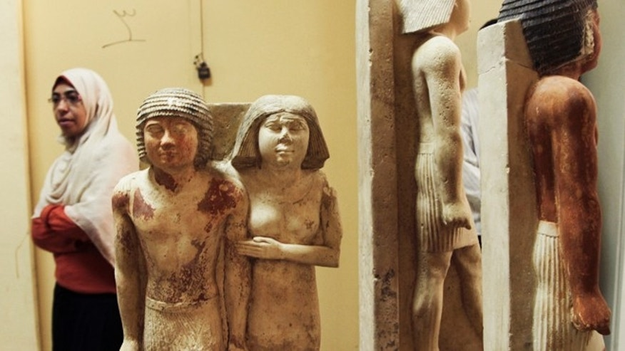 Nov. 14, 2012: Archaeologists display statues that were found in princess Shert Nebti's tomb in Giza, Egypt. Czech archaeologists have unearthed the 4,500-year-old tomb of a Pharaonic princess south of Cairo, in a finding that suggests other undiscovered tombs may be in the area.