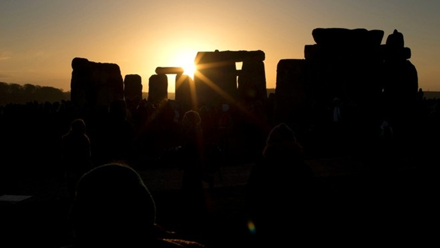 Dec. 21, 2012: The sun passes through the stones after rising at the ancient stone circle of Stonehenge, in southern England, as access to the site is given to druids, New Age followers and members of the public on the annual Winter Solstice.