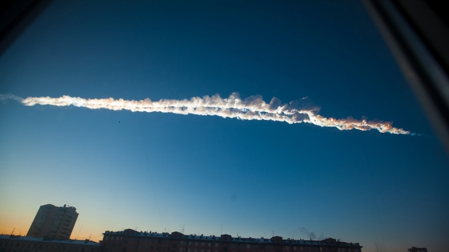 Feb. 15, 2013: A meteorite contrail is seen over Chelyabinsk. A meteor streaked across the sky of Russia's Ural Mountains on Friday morning, causing sharp explosions and reportedly injuring around 100 people, including many hurt by broken glass.