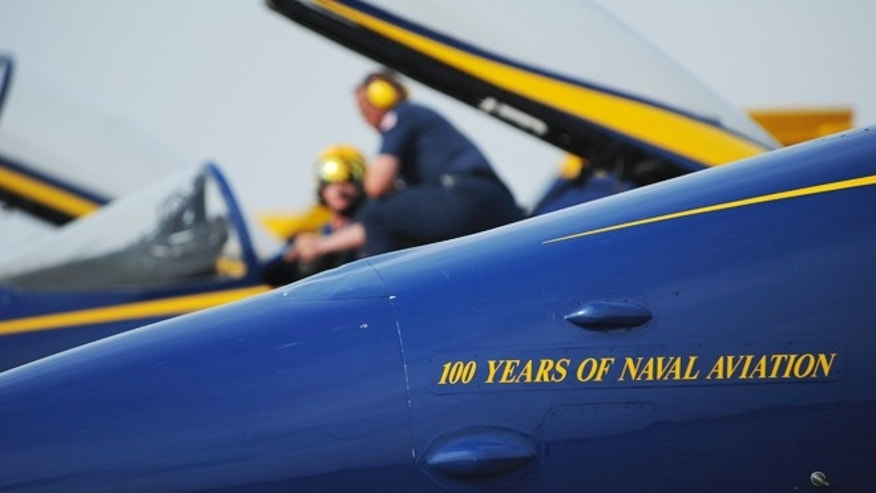The F/A-18 Hornets assigned to the U.S. Navy flight demonstration squadron, the Blue Angels, display new graphics in celebration of the Centennial of Naval Aviation.