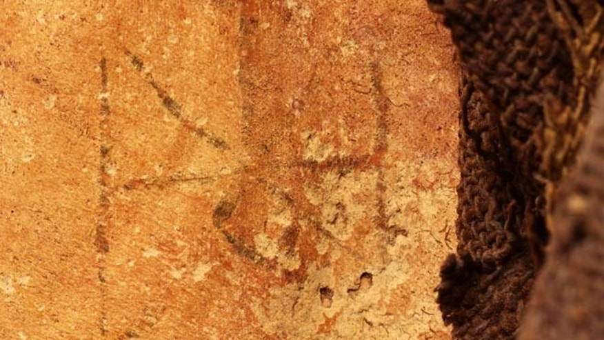 Photograph of the tattoo found on the mummified remains of a Sudanese woman.