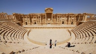Tourists take pictures at the ancient Palmyra theater in the historical city of Palmyra April 18, 2008. Islamic State fighters in Syria have entered the ancient ruins of Palmyra after taking complete control of the central city, but there are no reports so far of any destruction of antiquities, a group monitoring the war said on May 21, 2015. Picture taken April 18, 2008. REUTERS/Omar Sanadiki - RTX1DX3J