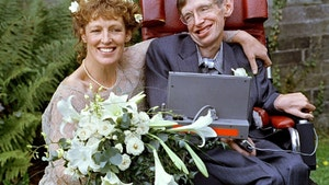 Stephen Hawking and his new bride Elaine Mason pose for pictures after the blessing of their wedding at St. Barnabus Church September 16. The two are going on honeymoom is Scotland - PBEAHUNDOCB