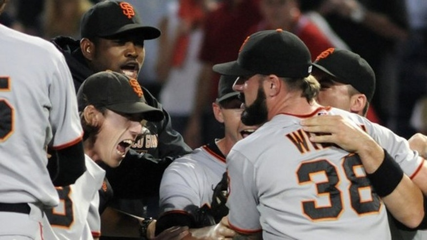 Oct. 11: San Francisco Giants starting pitcher Tim Lincecum (L) celebrates with relief pitcher Brian Wilson (38) after defeating the Atlanta Braves to advance to the NLCS.