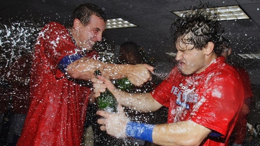 Oct. 13: Texas Rangers' Ian Kinsler, right, gets sprayed with champagne following the team's 5-1 win over the Tampa Bay Rays during Game 5 of baseball's American League Division Series in St. Petersburg, Fla. The Rangers advanced to the AL championship series against the New York Yankees.