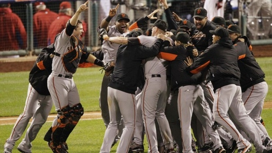 Oct. 23: The San Francisco Giants celebrate after the ninth inning of Game 6 of baseball's National League Championship Series against the Philadelphia Phillies in Philadelphia.