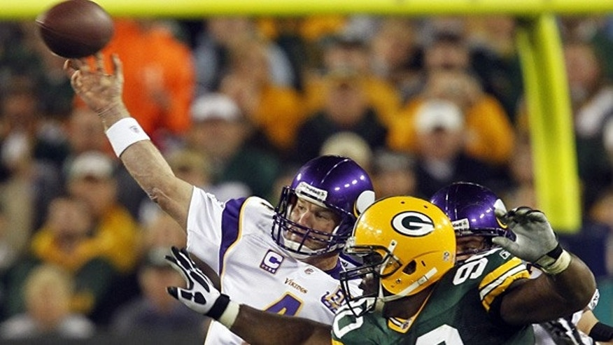 Oct. 24: Vikings quarterback Brett Favre throws with Green Bay Packers defensive tackle B.J. Raji rushing.