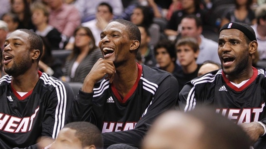 Oct. 9: Miami Heat's Dwyane Wade, left, Chris Bosh, center, and LeBron James react on the bench during the second quarter of an NBA preseason basketball game against the San Antonio Spurs in San Antonio.