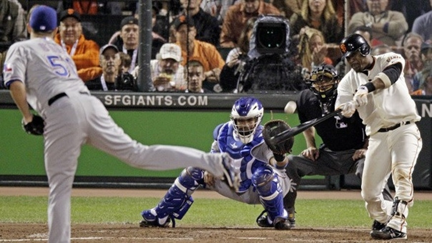 Oct. 27: Giants' Juan Uribe hits a three-run home run during the fifth inning of Game 1 in San Francisco.