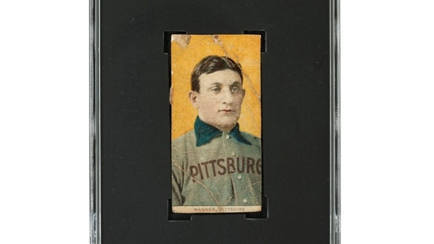 This undated photo provided by Heritage Auctions shows a rare century-old T206 Honus Wagner baseball card.