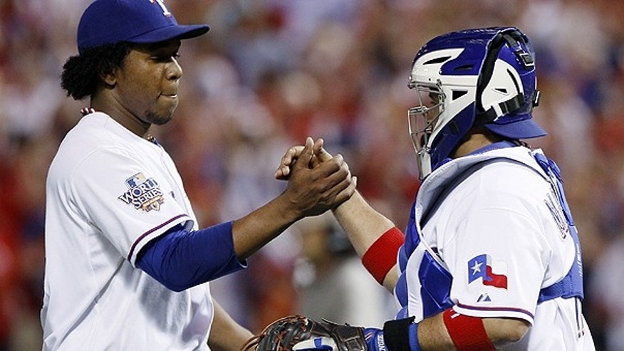 Oct. 30: Texas Rangers' Neftali Feliz is congratulated by catcher Bengie Molina after Game 3 of baseball's World Series against the San Francisco Giants.