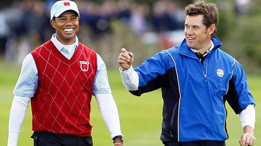 Oct.  3: Tiger Woods walks with Lee Westwood after finishing their match during the 2010 Ryder Cup golf tournament at the Celtic Manor Resort in Newport, Wales.