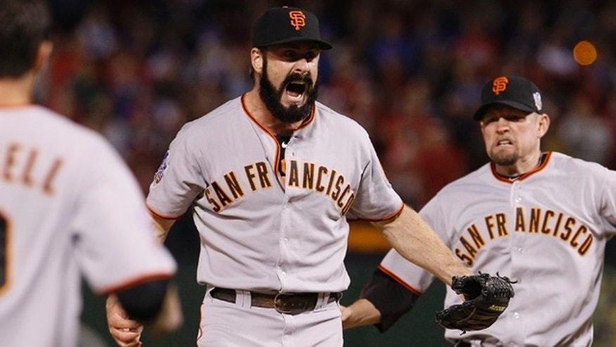 San Francisco Giants' Brian Wilson celebrates after Game 5 of baseball's World Series against the Texas Rangers Monday, Nov. 1, 2010, in Arlington, Texas. The Giants won 3-1 to capture the World Series. (AP Photo/Matt Slocum)