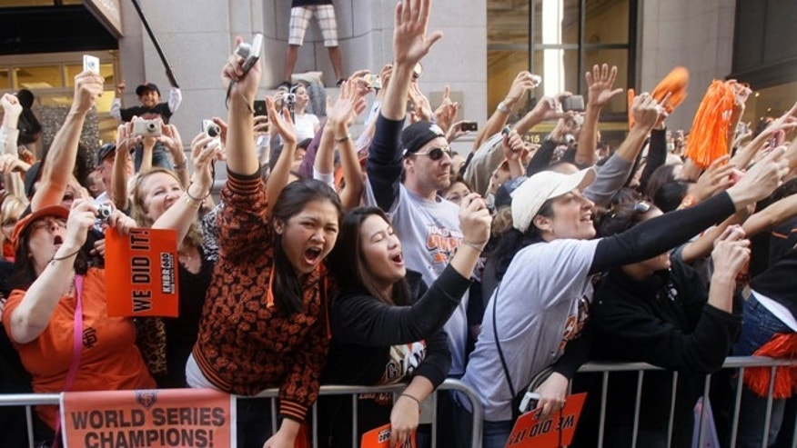 Nov. 3: San Francisco Giants fans celebrate during a baseball World Series parade in downtown San Francisco.