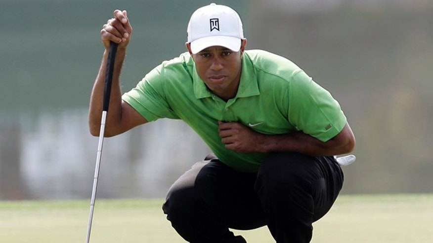 Nov. 4: Tiger Woods of the United States lines up a putt on the 18th green during the first round of the HSBC Champions golf tournament at the Shanghai Sheshan International Golf Club in Shanghai, China.