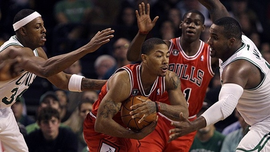 Nov. 5: Chicago Bulls guard Derrick Rose, center, is surrounded by Boston Celtics forwards Paul Pierce, left, and Glen Davis, right, during the first half of their NBA basketball game in Boston.