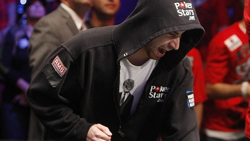 Nov. 6: Jonathan Duhamel reacts after winning an all-in hand during the final table of the World Series of Poker.