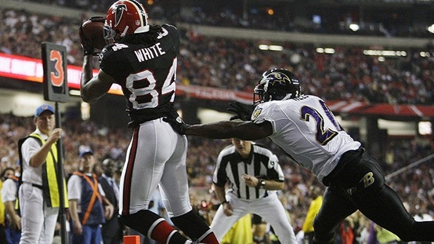Nov.11: Atlanta Falcons wide receiver Roddy White (84) a touchdown pass as Baltimore Ravens safety Ed Reed (20) defends in the fourth quarter in Atlanta.