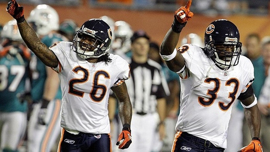 Nov. 18: Chicago Bears cornerbacks Charles Tillman (33) and Tim Jennings (26) celebrate after Tillman intercepted a pass during the first quarter of an NFL football game against the Miami Dolphins in Miami.