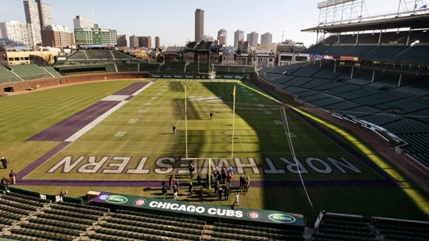 Pictured is Wrigley Field, lined for next Saturday's college football game between Northwestern University and University of Illinois Monday, Nov. 15, 2010 in Chicago. (AP Photo/Charles Rex Arbogast)