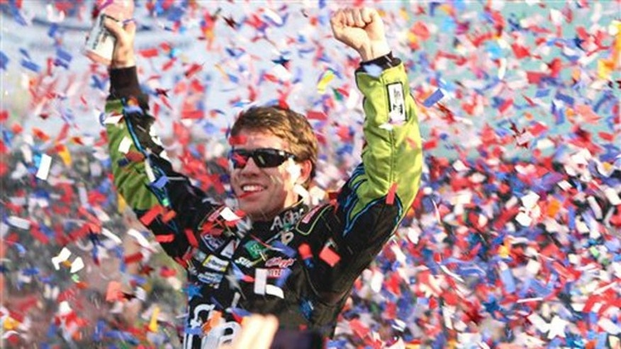 NASCAR driver Carl Edwards celebrates after winning the Ford 400 auto race Sunday, Nov. 21, 2010 in Homestead, Fla.