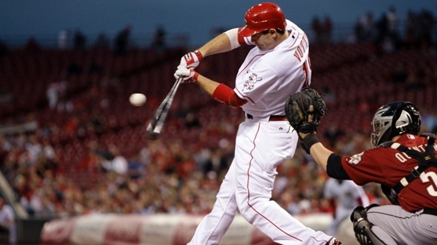 This Sept. 30, 2010, file photo shows Cincinnati Reds first baseman Joey Votto batting against the Houston Astros in a baseball game in Cincinnati.