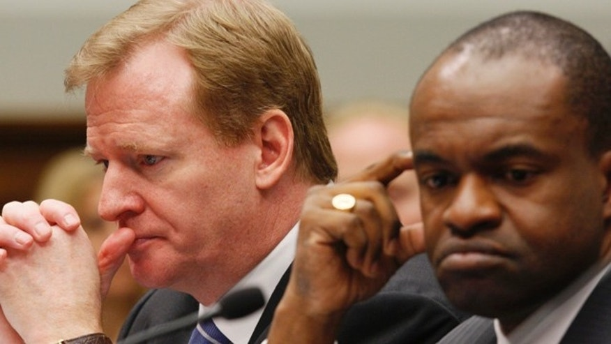 This Oct. 28, 2009, file photo shows NFL Players Association Executive Director DeMaurice Smith, right, and NFL Commissioner Roger Goodell, at the witness table on Capitol Hill in Washingto, during a House Judiciary Committee hearing on legal issues relating to football head injuries.