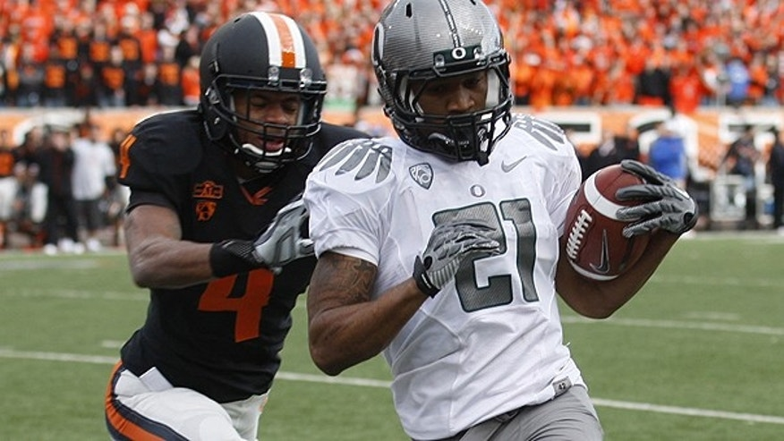 Dec. 4: Oregon running back LaMichael James (21) runs the ball in for a score as Oregon State cornerback James Dockery (4) defends in the second quarter of an NCAA college football game in Corvallis, Ore.