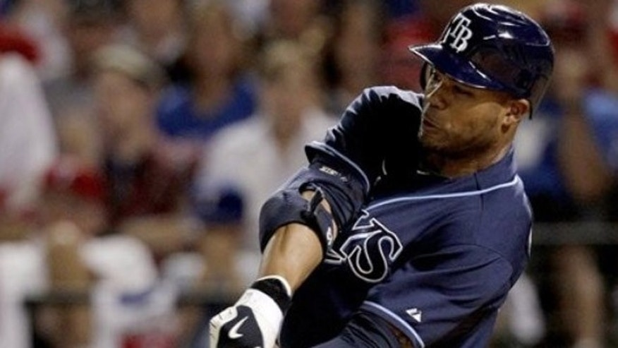 Oct. 9: Tampa Bay Rays left fielder Carl Crawford scores a solo home run against Texas Rangers relief pitcher Neftali Feliz during the ninth inning of the American League Division Series baseball game in Arlington, Texas.