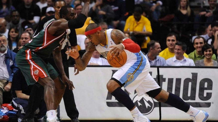 during the first quarter of an NBA basketball game Wednesday, Dec. 1, 2010, in Denver. (AP Photo/Jack Dempsey)