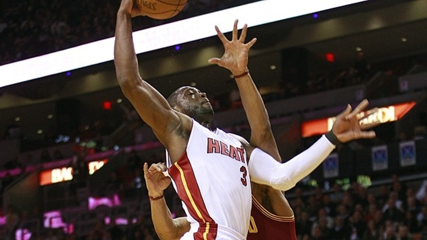 Dec. 15: Cleveland Cavaliers' Joey Graham, right, tries to block Miami Heat's Dwyane Wade from taking a two point shot during the first half of an NBA basketball game in Miami.