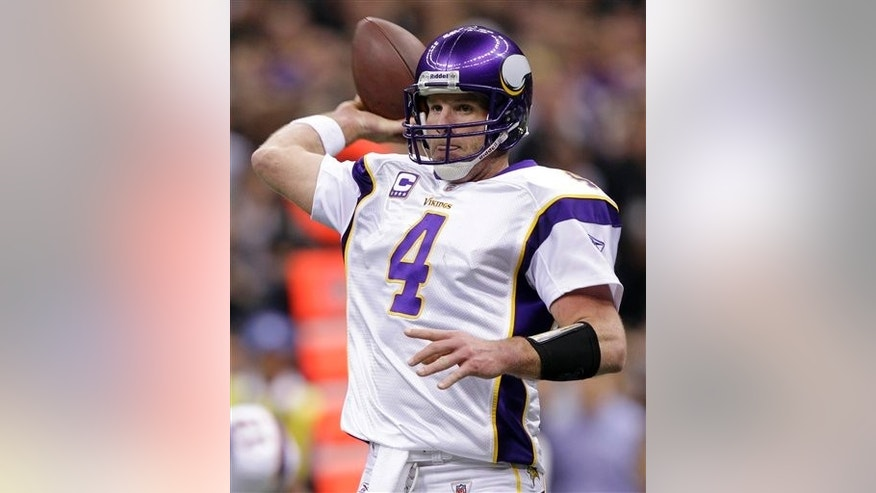 FILE - In this Jan. 24, 2010, file photo, Minnesota Vikings quarterback Brett Favre throws during the NFC Championship NFL football game against the New Orleans Saints in New Orleans. (AP Photo/Morry Gash,File)