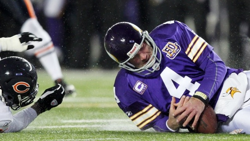 Dec. 20, 2010: Minnesota Vikings' Brett Favre grabs a fumbled snap in front of Chicago Bears' D.J. Moore.