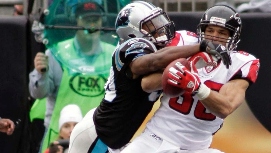 Atlanta Falcons' Tony Gonzalez, right, catches a touchdown pass as Carolina Panthers' James Anderson, left defends during the first half of an NFL football game in Charlotte, N.C., Sunday, Dec. 12, 2010. (AP Photo/Rick Havner)