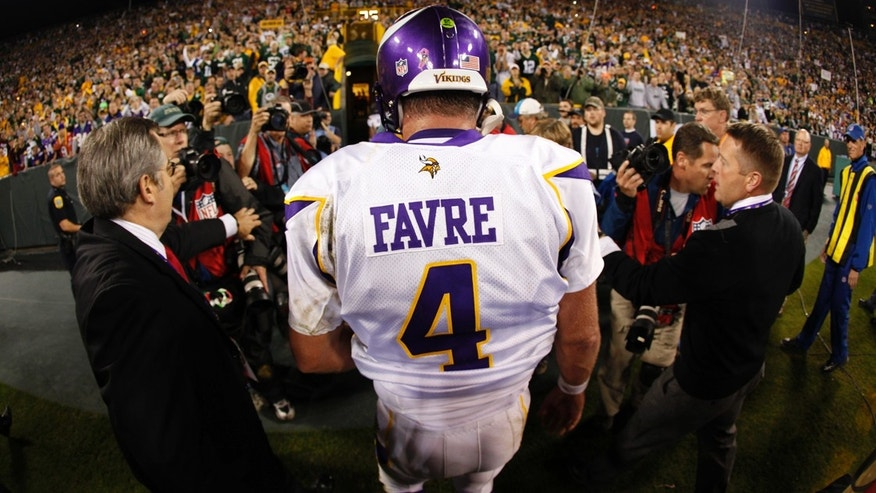 Oct. 24, 2010L: Minnesota Vikings quarterback Brett Favre walks off the field at Lambeau Field after a game against the Green Bay Packers.
