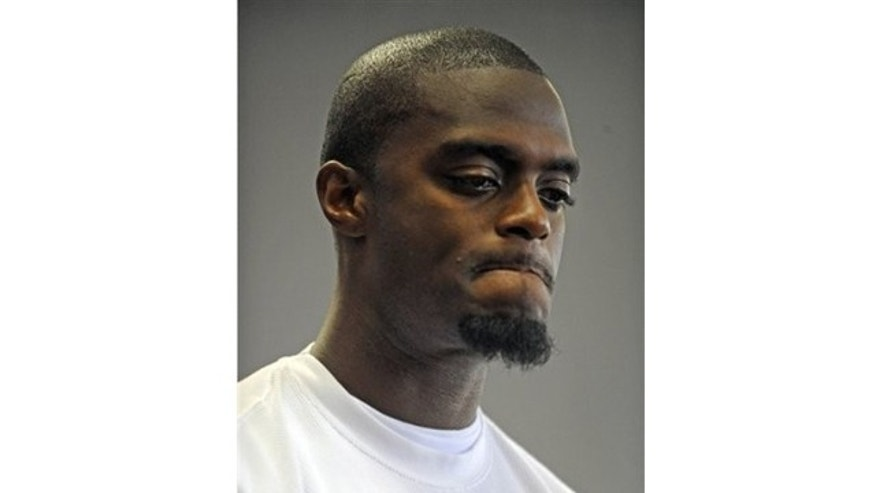 This is a Sept. 22, 2009, file photo showing ex-Giants star Plaxico Burress grimacing as he appears before judge Michael Melkonian for his sentencing in Manhattan criminal court, in New York.