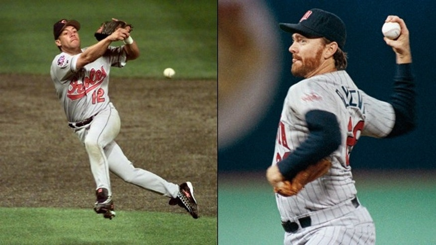 Robert Alomar, left, and Bert Blyleven were elected to baseball's Hall of Fame.