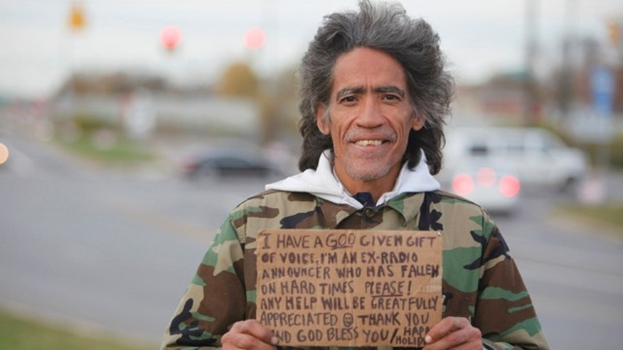In this photo taken in late December, 2010, Ted Williams holds a sign advertising his smooth radio voice near a highway ramp in Columbus, Ohio.