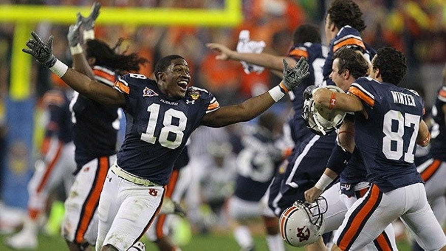 Jan. 10: Auburn's Kodi Burns (18) and teammates celebrate after beating Oregon 22-19 in the BCS National Championship game in Glendale, Ariz.