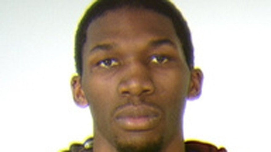 Mugshot of University of Minnesota basketball player Trevor Mbakwe.