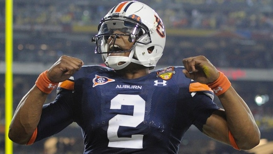 Jan. 10: Auburn's Cam Newton reacts after a touchdown during the first half of the BCS National Championship NCAA college football game against Oregon in Glendale, Ariz.