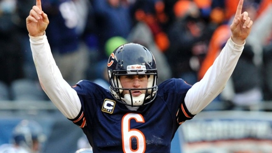 Chicago Bears quarterback Jay Cutler (6) reacts to a touchdown against the Seattle Seahawks during the second half an NFL divisional playoff football game Sunday, Jan. 16, 2011, in Chicago. (AP Photo/Jim Prisching)