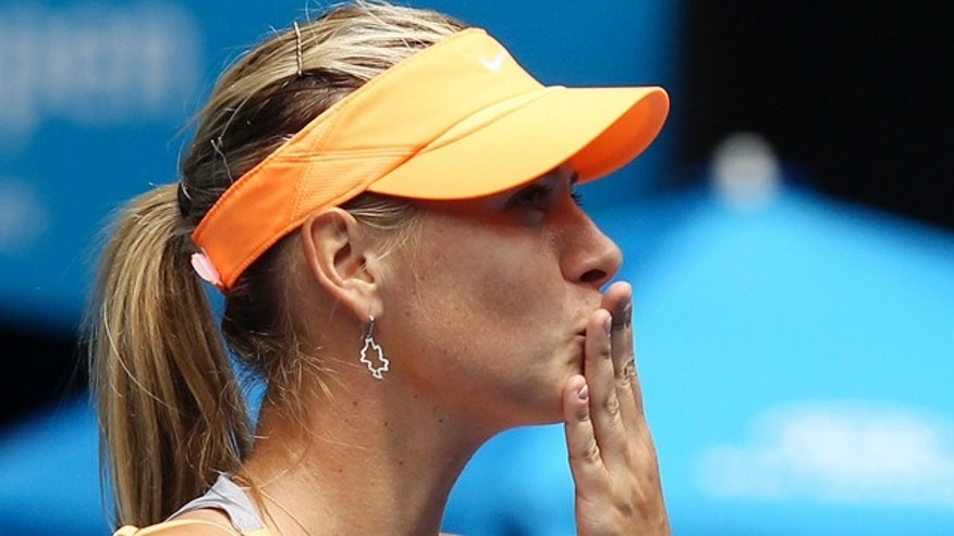 Jan. 17: Russia's Maria Sharapova blows kisses to the crowd following her first round match against Thailand's Tamarine Tanasugarn at the Australian Open tennis championships in Melbourne, Australia.