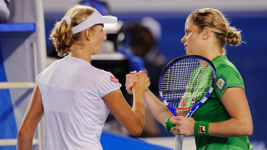 Jan. 24: Belgium's Kim Clijsters, right, is congratulated by Russia's Ekaterina Makarova after their fourth round match at the Australian Open tennis championships in Melbourne, Australia.