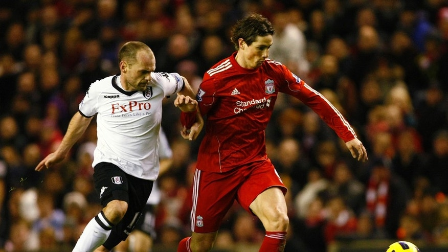 Liverpool's Fernando Torres, right, vies for the ball against Fulham's Danny Murphy during their English Premier League soccer match at Anfield, Liverpool, England, Wednesday Jan. 26, 2011. (AP Photo/Tim Hales) NO INTERNET/MOBILE USAGE WITHOUT FOOTBALL ASSOCIATION PREMIER LEAGUE (FAPL) LICENCE. CALL +44 (0) 20 7864 9121 or EMAIL info@football-dataco.com FOR DETAILS
