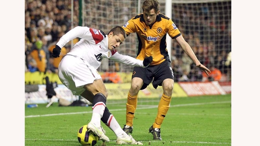 Manchester United's Javier Hernandez, left, competes for the ball with Wolverhampton Wanderers' Richard Stearman during their English Premier League soccer match at the Molineux stadium, Wolverhampton, England, Saturday, Feb. 5, 2011. (AP Photo/Simon Dawson) NO INTERNET/MOBILE USAGE WITHOUT FOOTBALL ASSOCIATION PREMIER LEAGUE (FAPL) LICENCE. CALL +44 (0) 20 7864 9121 or EMAIL info@football-datco.com FOR DETAILS
