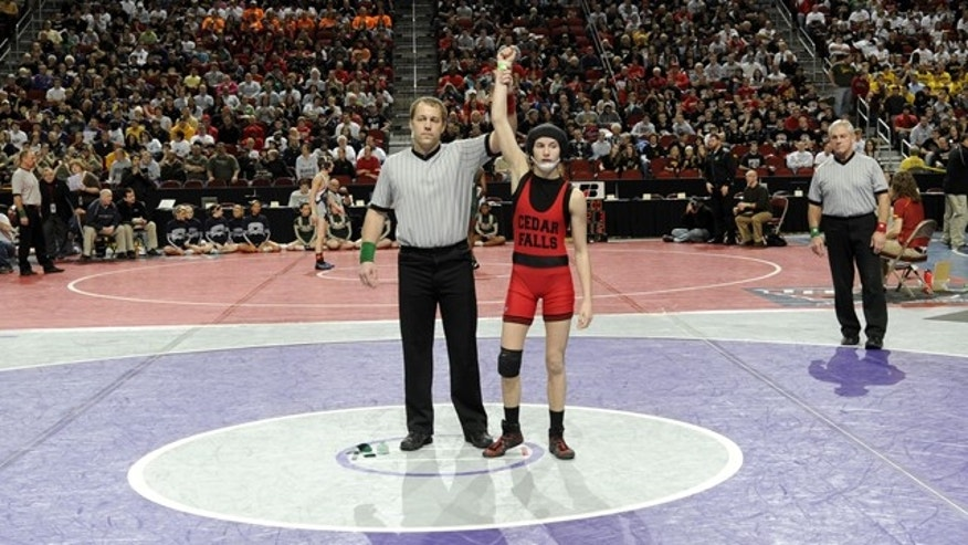 Feb. 17: Cedar Falls' Casey Herkleman gets her arm raised after winning by default in a Class 3A 112 pound match at the Iowa State Wrestling tournament in Des Moines, Iowa.