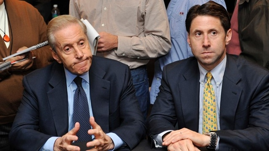 Oct. 29, 2010: New York Mets owner Fred Wilpon, left, and COO Jeff Wilpon, listen to a question from the media during a baseball news conference in New York.