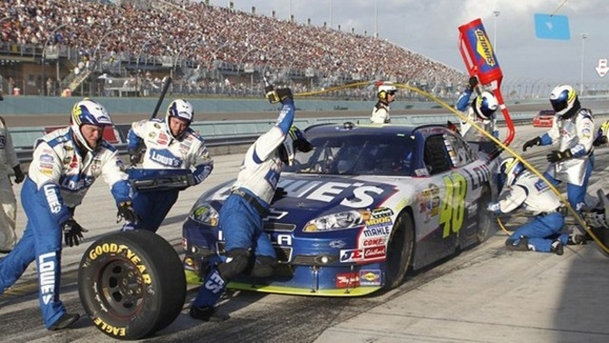 Jimmie Johnson makes a pit stop in the final laps as he won the 2010 NASCAR Sprint Cup Series championship at the Ford 400 race in Homestead, Florida November 21, 2010.